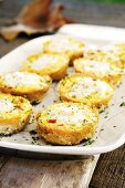 Muffins with eggs, tomatoes and ricotta