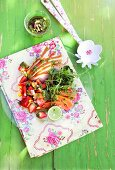 Papaya salad with smoked chicken and pistachio pesto