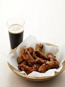 Bowl of Chicken Wings with a Glass of Beer