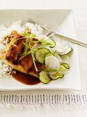 Glazed Chicken with Sliced Cucumbers and Parsnips Over Rice; In a Square Bowl with a Fork