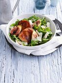 Bowl of pork medallions with salad