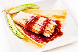 Spicy Tamale with Husk Peeled Open