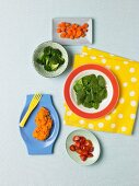 Assorted Vegetables Containing Beta Carotene: Baby Spinach, Broccoli, Grape Tomatoes, Sweet Potatoes and Carrots