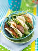 Parmesan wafers with smoked salmon and rocket