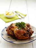 Rotisserie chicken stuffed with couscous, nuts and parsley