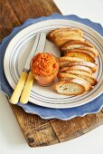 Toasted baguette slices with rouille (puréed pepper spread)