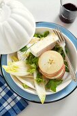 Salad with chicory, apple slices, Camembert and a Dijon dressing