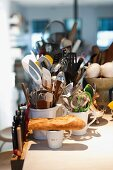 Close up of assorted kitchen utensils in porcelain cups