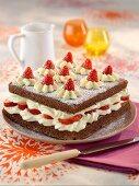 Chocolate sponge cake with white chocolate cream and fresh strawberries