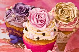 Celebratory cupcakes decorated with buttercream and sugar roses