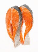 Two Salmon Steaks on a White Background
