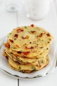 Semolina biscuits made with wheat semolina, chickpea flour, tomatoes and chillis (India)