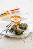 Spinach and pine nut cakes with a dip