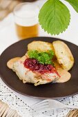 Kaldolmar (Swedish cabbage roulade) with lingonberry sauce and potatoes