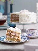 Buckwheat cake with lingonberries, cream and meringue