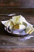 Green tea ice cream parfait with matcha sticks