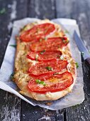 Pizza topped with plum tomatoes