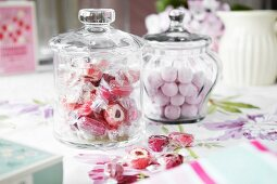 Jars of candies on table