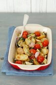 Oven-baked vegetables (potatoes, courgettes, shallots, tomatoes)