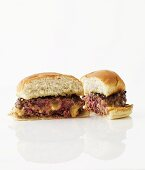 Halved Cheese Stuffed Hamburger on a White Background