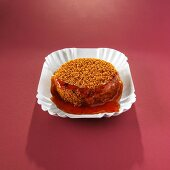 A breaded bami slice with sauce