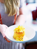 Soaked coconut pudding with pineapple flowers