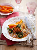 Spicy baked chicken with yoghurt, rice and carrots