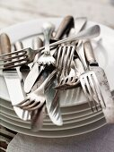 Cutlery on a stack of plates