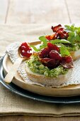 Bruschetta spread with avocado, with Parma ham and rocket