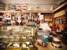 Baker at register in cake shop