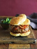 Hamburger with Grilled Onions and Peppers on a Sesame Seed Bun