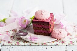 Mini berry layer cake decorated with a macaroon