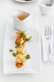 Scallops on toasted bread and tomato juice