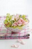 Pink roses and lady's mantle in a bowl