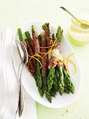 Grilled asparagus wrapped in Serrano ham