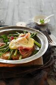 Toasted bread with green asparagus, ham and cheese