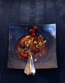 Osso buco (pot-roasted sliced leg of veal, Italy)
