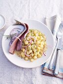 Soused herrings with potato risotto and onions
