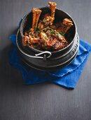 Algerian pot-roast dish with lamb shanks in a potjiekos cooking pot