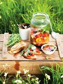 Tomato and olive salad in a storage jar