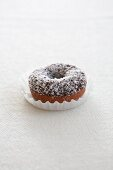 A doughnut with chocolate glaze and grated coconut