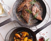 Fried veal liver with fried peaches