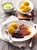 Venison with plum sauce and duchess potatoes