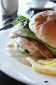 Chicken and avocado burger with chips