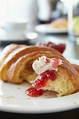 A croissant with butter and jam