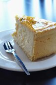 A slice of New York cheesecake with passion fruit glaze