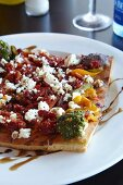 Unleavened bread topped with peppers and feta cheese