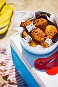 Chicken drumsticks at a picnic