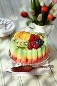 An ice cream cake with fresh fruit