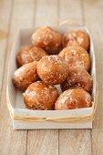 Mini doughnut holes with a sugar glaze